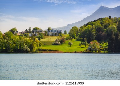 Beautiful nature view of Lake Lucerne waterfront while sailing in the lake