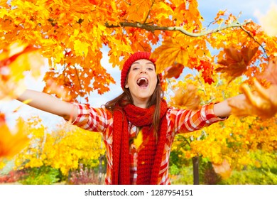 beautiful nature woman in sunny october day leaf
