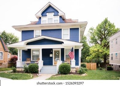 Beautiful navy blue colonial with large front porch in historic Dougherty neighborhood, Independence Missouri - Shutterstock ID 1526393297