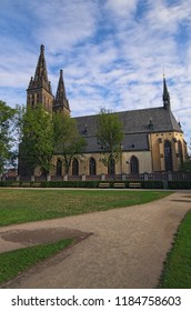 """Beautiful Neo Gothic Church of Saint Peter and Paul in Vysehrad (""""Upper Castle""""). Summer landscape photo on a sunny morning. Prague, Czech Republic."""