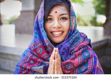 beautiful nepalese woman saying and performing namaste gesture