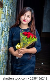 Beautiful Nepali Girl with Red Rose