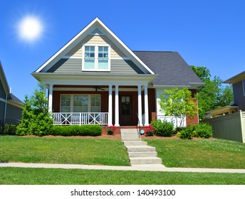 Beautiful, New England Style Suburban American Home with Large Front Porch in the Summertime