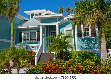 Beautiful New Florida House with Palm Trees and Landscaping Near the Beach. Would Make a Great Vacation Rental Property.