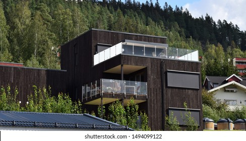 Beautiful new modern residence home apartments with roof terrace expensive architecture exterior, facade and estate in sunny and summer season - Kongsvinger, Norway