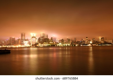 Beautiful New York City skyline at night and representation of Hudson River like it is frozen , view from hoboken area at New Jersey