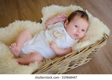 beautiful newborn baby in a basket lying