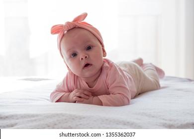 Beautiful newborn baby girl with pink headband