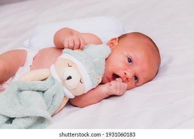 Beautiful newborn baby lying on bed