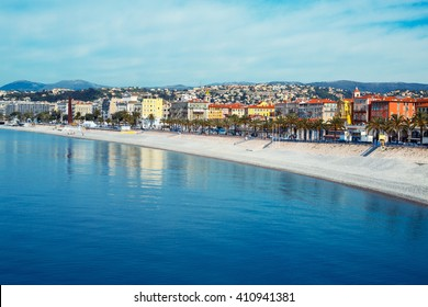 Beautiful Nice promenade, France. View of the sea, beach and Promenade des Anglais Embankment. French Riviera - turquoise sea and perfect recreation.