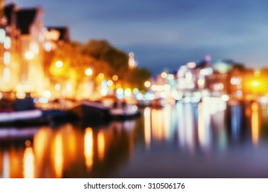 Beautiful night in Amsterdam. Natural blurred background. Soft light effect.