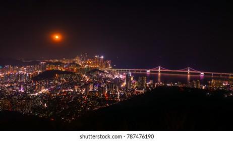 Beautiful night of Busan, South Korea. Night view of Gwangan bridge and Gwangalli beach in Busan city, South Korea.