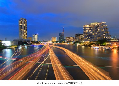 Beautiful night city bangkok with speed light on river