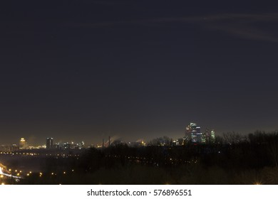 Beautiful night city with skyscrapers far behind
