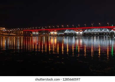 Beautiful Night city view, bridge over the river with beautiful illumination, Krasnoyarsk Russia, Yenisei River, Nikolaevsky bridge