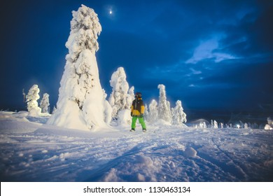 Beautiful night cold scandinavian mountain view of ski resort, sunny winter day with slope, piste and ski lift