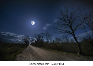 Beautiful night landscape of big full moon rising over the mountain road with hill and trees, mystical concept. Azerbaijan