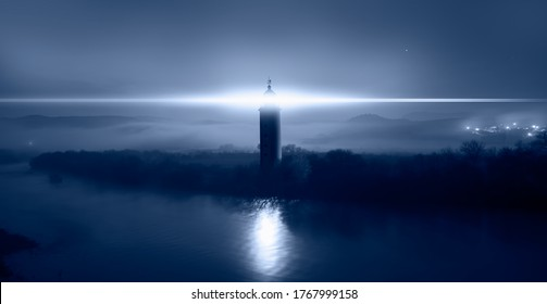 Beautiful night landscape with lighthouse at dark night