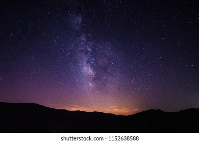 Beautiful night landscape with the milky way in a starry night of Juzcar, small village of the Spanish Andalucia.