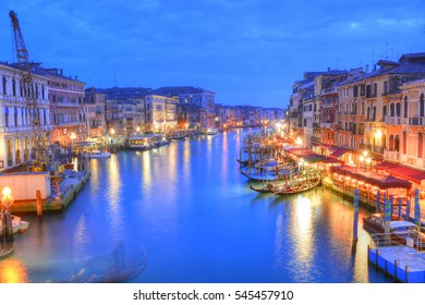 Beautiful night scene over the Grand Canal with buildings reflected in water in Venice city, Italy