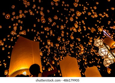 A beautiful night scene showing floating lanterns flying into the sky on Loy Krathong festival in Chiang Mai, Thailand.