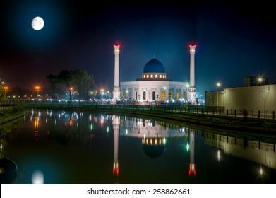 Beautiful Night Shot of Big New Mosque Minor, With Reflection in Water Under a Full Moon. Uzbekistan, Tashkent.
