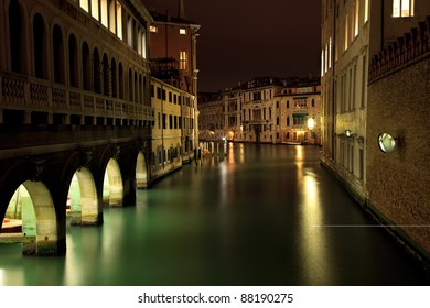 Beautiful night shot of canals in Venice, Italy, with rich houses alongside the water