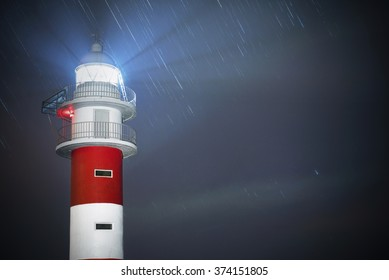 Beautiful night shot of a lighthouse with star trails in the background in Punta de Teno, Tenerife, Canary island,  Spain.