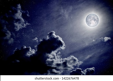 Beautiful night sky with clouds and full moon