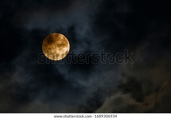 A beautiful night sky with the full moon. Dramatic cloudy sky at night.