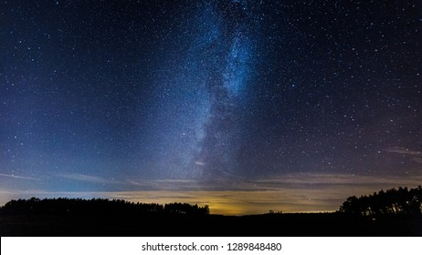 Beautiful night sky with Milky Way over fields. Natural high ISO photography with sky.