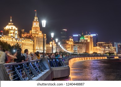 Beautiful night view of the Bund (Waitan) at downtown of Shanghai, China. The embankment of the Huangpu River is a popular tourist attraction of Asia.