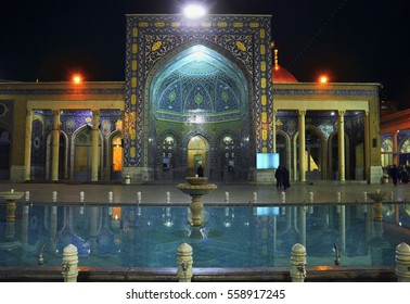 Beautiful night view of Fatima Masumeh (Mosoumeh, Al-Masumah) Shrine portal decorated with blue tile and water pool in Qom (Qum, Komb, Koama) - the holy city for Shia Muslims, Iran, Middle East