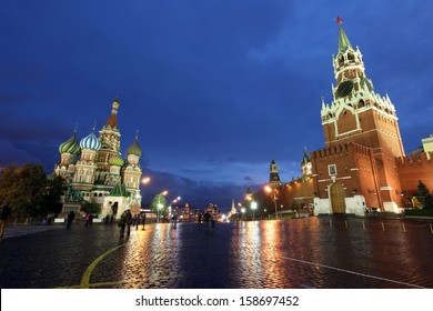 Beautiful Night View of Intercession Cathedral (St. Basil's) and the Spassky Tower of Moscow Kremlin at Red Square in Moscow, Russia