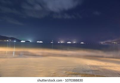 Beautiful night view of landscape and boats on Patong Beach , Phuket.