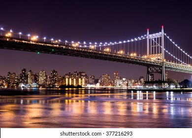 Beautiful night view of New York City and RFK Triborough Bridge looking across to Manhattan.