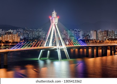 Beautiful night view of Olympic Bridge over the Han River (Hangang) at downtown of Seoul in South Korea. Colorful city lights reflected in water. Amazing cityscape.