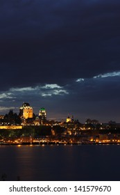 Beautiful night view in Quebec city above Saint Lawrence river in a cloudy spring day.