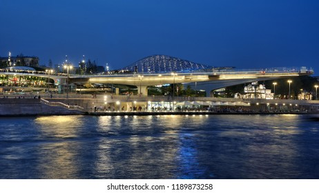Beautiful night view from Raushskaya embankment of Moskva River (Moscow River) on the modern park Zaryadye built in September 2017 on the site of former hotel Rossiya in twilight