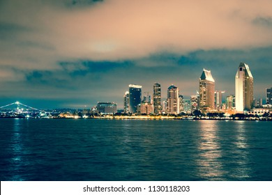 Beautiful night view of San Diego California skyline with lights and bay