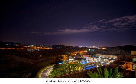 Beautiful night view in Spain, Canary islands. Scene from above. Luxury hotel view. Maspalomas city lights on the horizon.