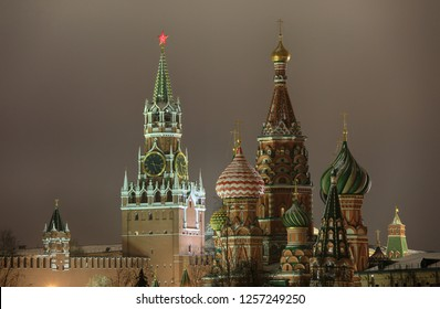 Beautiful night view of the Spasskaya Tower of the Moscow Kremlin and the dome of St. Basil's Cathedral in Moscow