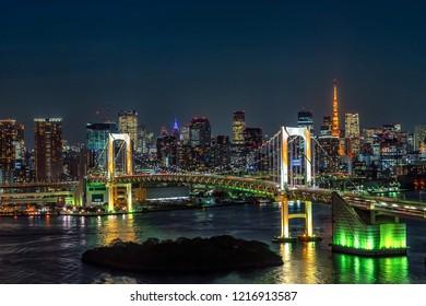 Beautiful night view of Tokyo Bay, Rainbow bridge and Tokyo Tower landmark Twilight scene, Odaiba, Japan