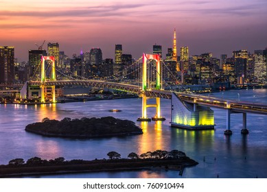 Beautiful night view of Tokyo Bay , Rainbow bridge and Tokyo Tower landmark Twilight scene, Odaiba, Japan