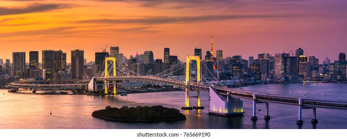 Beautiful night view of Tokyo Bay , Rainbow bridge and Tokyo Tower landmark Twilight scene, Odaiba, Japan