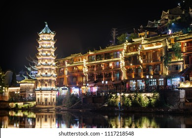 Beautiful night view of the Wanming Pagoda in Phoenix Ancient Town (Fenghuang County), China. Fenghuang is a popular tourist destination of Asia.