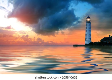 Beautiful nightly seascape with lighthouse and moody sky at the sunset