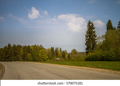 A beautiful norther Europe landscape with a road in late spring