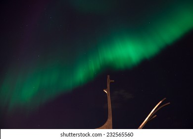 Beautiful northern light or aurora above the Sculpture of Sun Voyager (Solfar) designed by Jon Gunnar Arnason in Reykjavik, Iceland