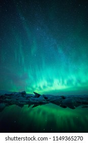 Beautiful northern lights over glacier lagoon in south east Iceland. Aurora borealis up north in Iceland. Night photography landscape with northern lights.